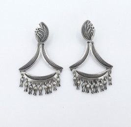 Steven Tiffany silver earrings with petite squash blossom fringe.