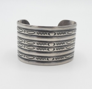 Wide stamped, ribbed silver Navajo old pawn cuff.
