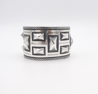 Wide geometric stamped cuff by contemporary artist, McKee Platero.