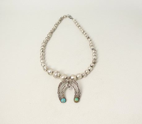Vintage Navajo Naja pendant on Mexican silver beads