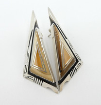 Jerry T. Nelson, a Dine artist- fossilised marine ivory and silver channel inlay earrings.