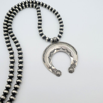 Contemporary Navajo silver stamped naja by Fritson Toledo strung on oxidised silver beads