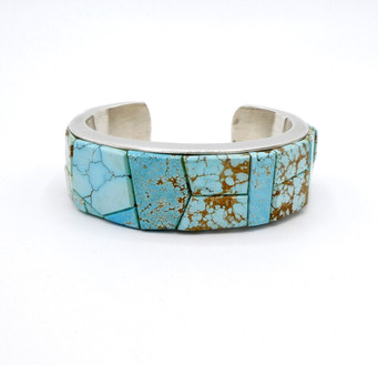Silver cuff with inlaid turquoise by Na Na Ping