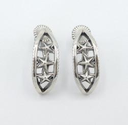 Silver star hoops by Cody Sanderson.
