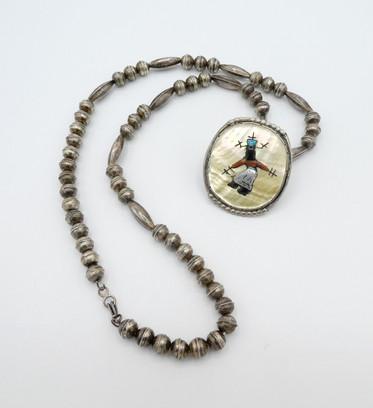 Vintage Zuni Gan dancer inlay pendant and silver long beads