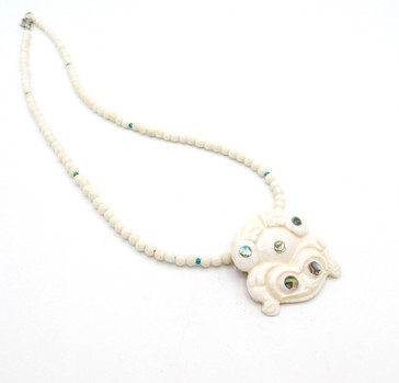 Patti Fawn hand carved fossil marine ivory frog and bead necklace with abalone detail