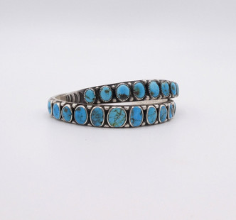 Two vintage Navajo turquosie row cuffs with stamping