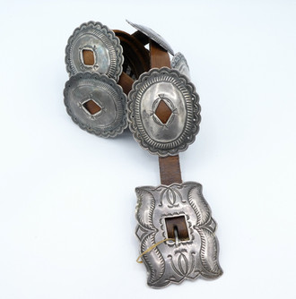 Lovely vintage Navajo open diamond slot stamped conch belt with buckle.