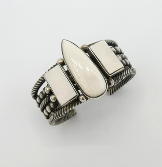 Marine ivory and silver cuff by Mike Bird Romero with twist wire detail and silver beads