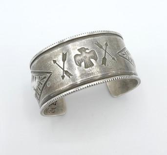 Stamped silver wide cuff by Navajo artist Greg Lewis