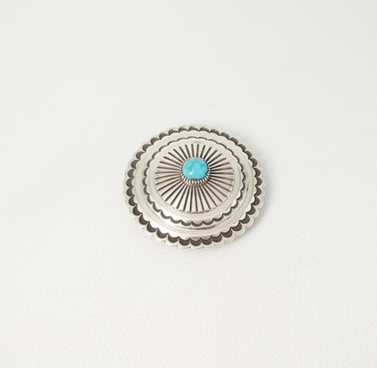 Contemporary silver sun rays stamped buckle set with turquoise