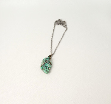 Vintage finely carved turquoise leaf with silver pendant and chain