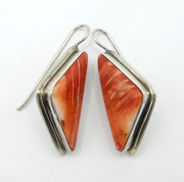 Contemporary Navajo orange spiny oyster shell and silver earrings.