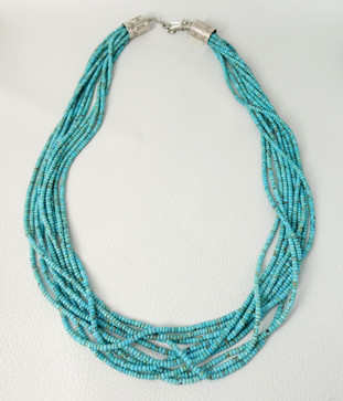 Ten strands of fine turquoise beads with silver returns.