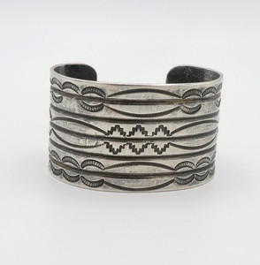 Wide old pawn silver cuff with sun rays stamping.
