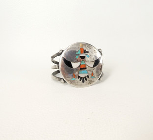 Vintage Zuni inlay silver cuff with knifewing ceremonial figure