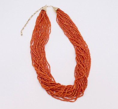 Superb twenty strand coral heishi with 18k gold by renowned artist.