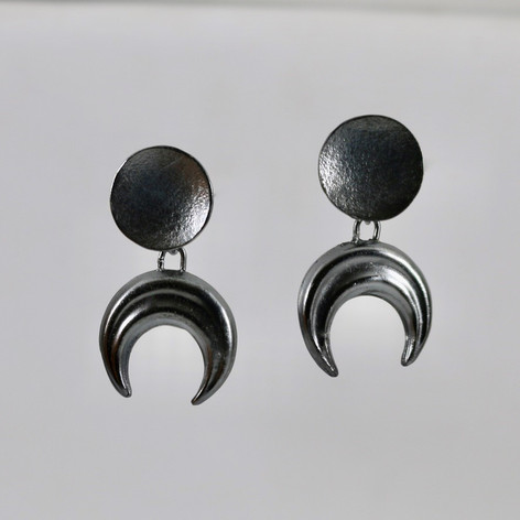 E20. Sterling silver oxidised moons.