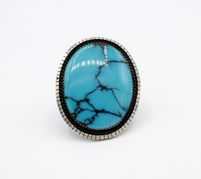 Vintage Navajo large turquoise stone with charcoal matrix and silver ring