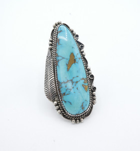 Navajo ring set with beautiful turquoise in a saw tooth bezel framed with intricate silver work