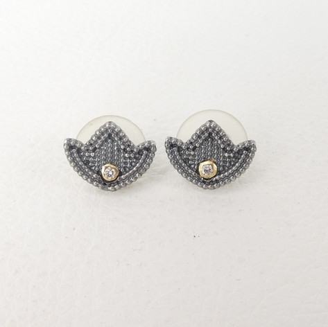 E19. Small tulip studs oxidized sterling with diamonds.