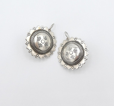 Vintage Navajo silver stamped button earrings.