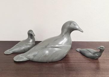 A family of ducks carved by Inuit artist Joe Kavik