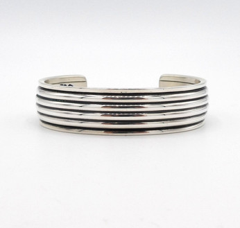 Silver linear cuff with stamped arrows on the inside by Navajo smith Cody Sanderson
