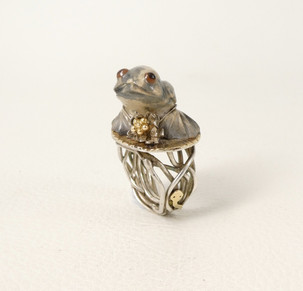 A collaboration by two, frog carving by Ricky Laahty and metalsmithing by Liz Wallace