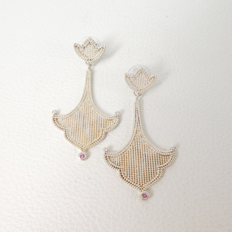 E8. Southern Plains wtih 3 stone abstract earrings diamonds and pink sapphires.