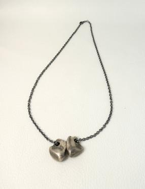 Artist Keri Ataumbi - silver oxidised elk cast teeth and chain