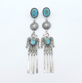 Exquisite Harry H. Begay silver thunderbird earrings with turquoise and hallmark.