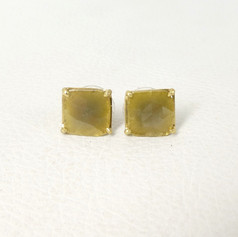 E23. 18ct, green diamond slab studs.