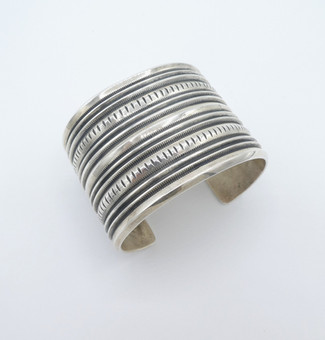 Fabulous wide sterling silver ridged cuff by Navajo smith Harrison Jim