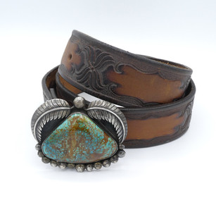 Vintage Navajo belt with amazing turquoise and silver buckle with great carved leather.