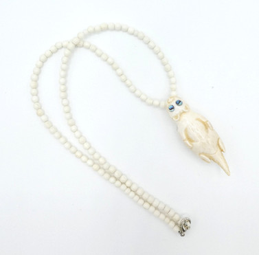 Fossilised Marine hand carved ivory necklace by artist Patty Fawn.