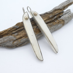 E6 Fossil Ivory with gold and silver earrings