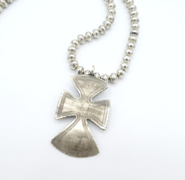 Large  silver cross by Fritson Toledo on contemporary silver beads