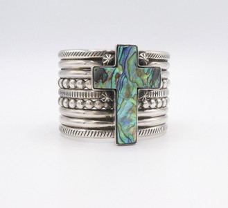 Silver and copper cuff with an Abalone cross by contemporary artist, Mike Bird Romero