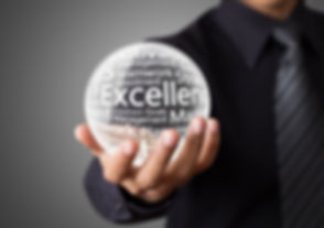 Businessman hand showing excellence word