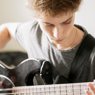 Teenger Playing Guitar