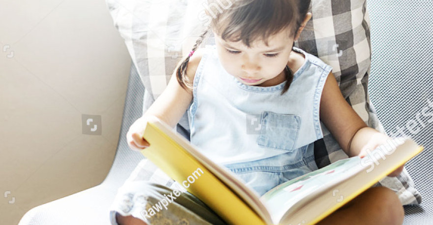 stock-photo-girl-book-casual-home-kinder