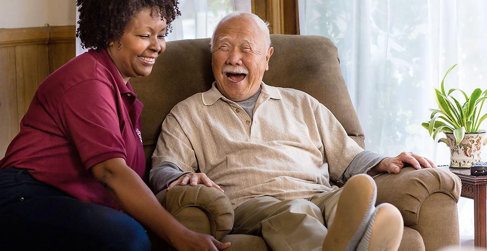 A woman helping an elderly man, doing caregiving, caregiver helper and assistance