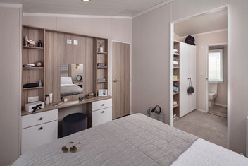 int-edmonton-lodge-main-bed-towards-vanity-area-and-wardrobe-swift.jpg