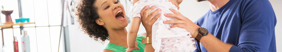 Couple with baby laughing