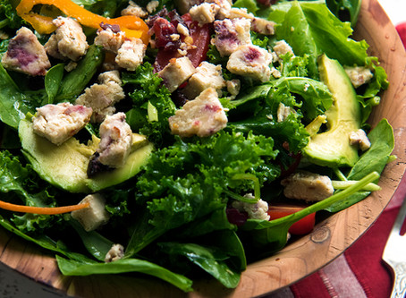 Avocado kale salad with cranberry and chili cheese