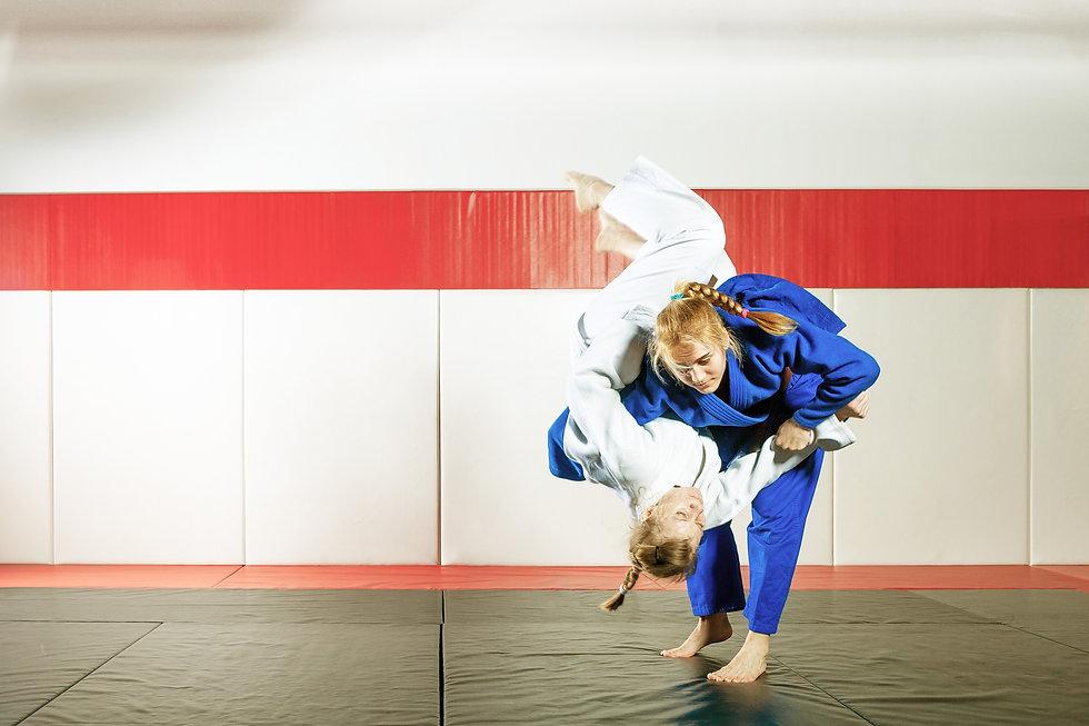 2 Women Brazillian Jiu-Jitsu Training Takedowns