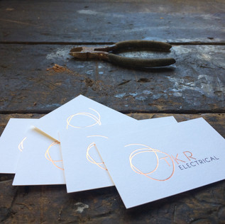 brand design and stationery for a female electrician with a beautiful yet professional outlook.    printing. laserfoil graphic designer. jessica barr