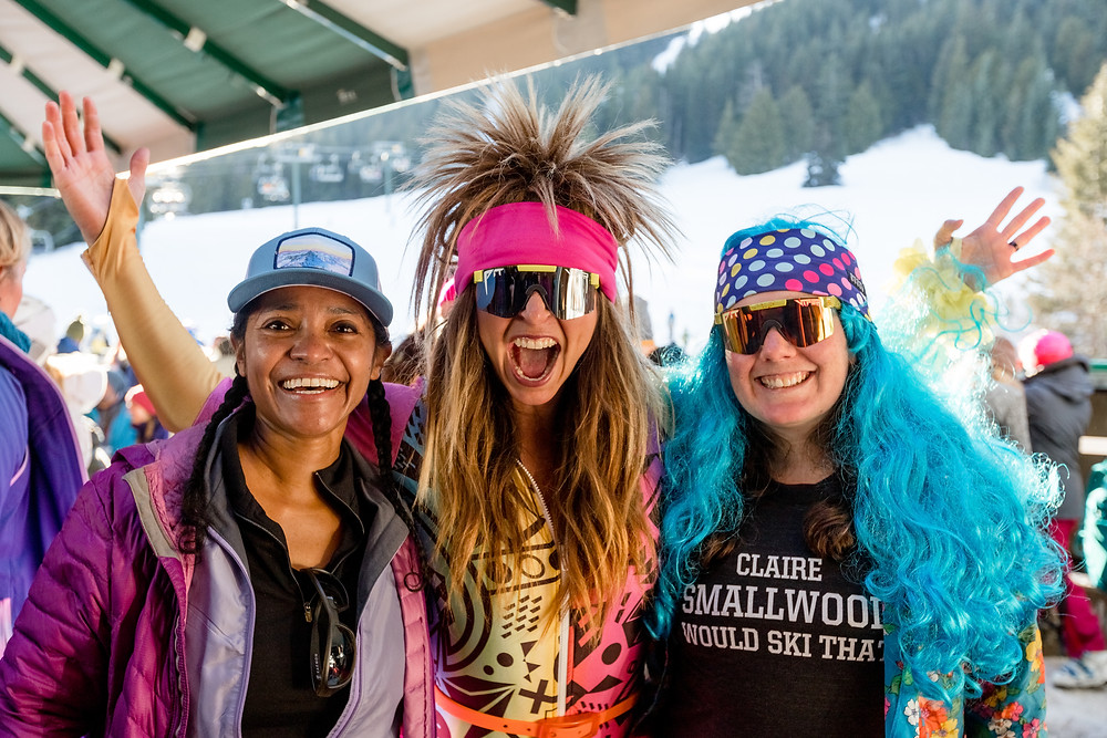 SheJumps volunteers at a ski event