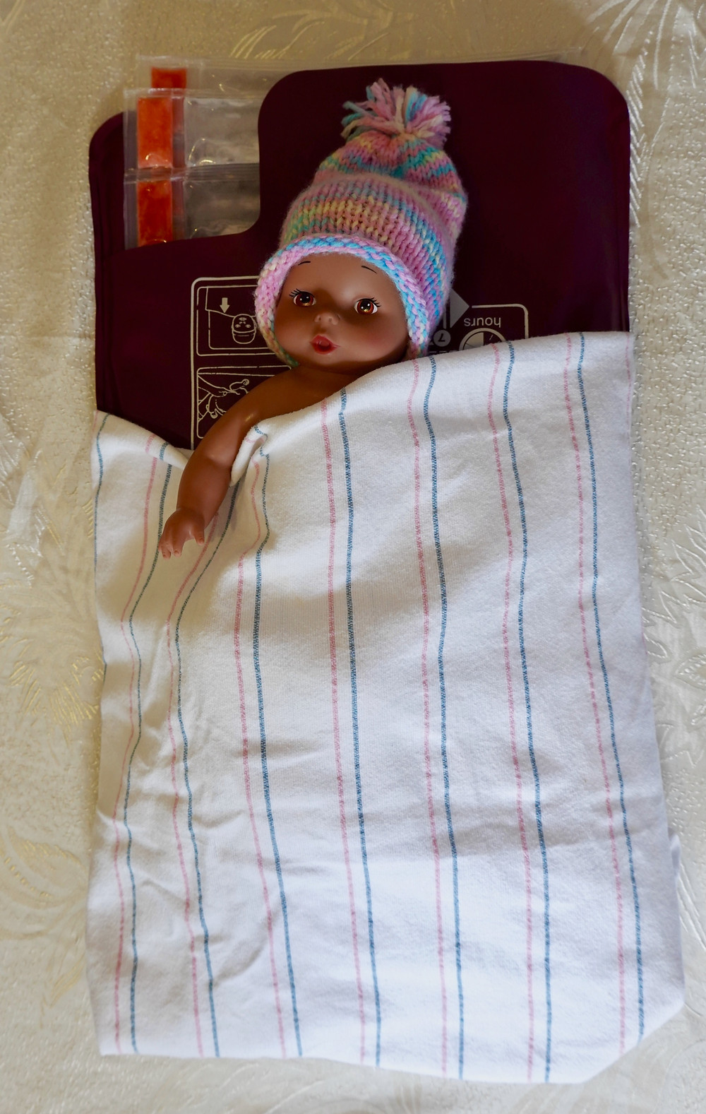 Doll on LBNL infant warming mat